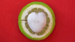 Heart shaped beach pebble on a lime slice of a Mojito cocktail in Notiammos bar in Kalamaki