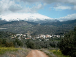 Lagolio from far with the snowy mountains behind the village